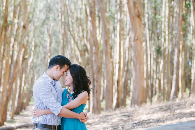 Presidio Woodline San Francisco engagement session. Couple hugging each other surrounded by eucalyptus trees.